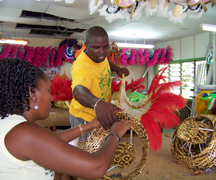 Members of SVG Players Int'l Mas Band work on costumes at their mas camp in Kingstown in preparation for Mardi Gras on July 7.