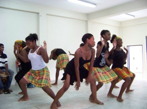 Young Garifuna girls from Sandy Bay, St. Vincent dance during a cultural performance in their village.