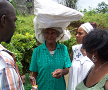 Visiting Garifunas chat with an elderly Garifuna woman in Sandy Bay.