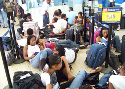 Liat Passengers Sit On The Floor At The E.t. Joshua Airport Two Weeks Ago While Waiting Almost 24 Hours For A Flight.