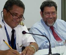 Prime Minister Dr. Ralph Gonsalves (R) and Cpt. Michael Blackburn of the LIAT Pilots Association.