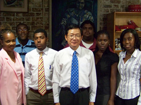 Taiwan ambassador to St. Vincent and the Grenadines, Leo Lee, pose with the scholarship recipients.