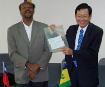 Taiwan ambassador in Kingstown Leo Lee (R) says his government is taking transparency a new literal level. Minister of National Mobilization in Kingstown Mike Browne is at left.