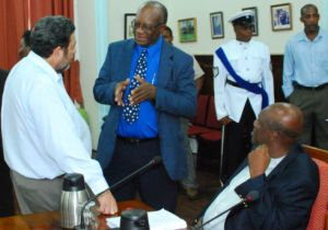 Prime Minister Gonsalves, CRSC Chairman Campbell and Opposition Leader Eustace chat in Parliament during debate of the constitution earlier this month. (Photo: Lance Neverson).