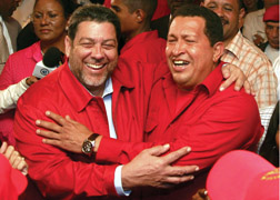 In this handout image released by Venezuela's Miraflores Press Office, Venezuela's President Hugo Chavez, right, is embraced by Saint Vincent and the Grenadines' Prime Minister Ralph Gonsalves upon Chavez's arrival to the Caribbean Island Friday, Feb. 16, 2007.  Kingstown will set up an embassy in Caracas next year. (AP Photo/Miraflores Press Office,HO)