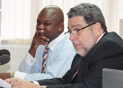 Prime Minister Dr. Ralph Gonsalves, right, at the press conference on Monday, Feb. 25, 2012. His Press Secretary, Hans King, is at left.