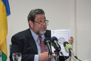 Gonzileaks: Prime Minister and Minister of Finance, Dr. Ralph Gonsalves, displays a confidential report from 2009 on the Building & Loan Association at a press conference in Kingstown, on Tuesday, Feb. 12. Gonsalves read sections of the report, against the explicitly written warning of the Ministry of Finance, which prepared it. (I-Witness News photo)