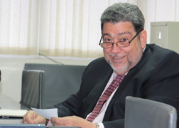 Prime Minister Dr. Ralph Gonsalves reacts at a press conference in Kingstown on Monday, Feb. 25, 2013, after reading a note from one of his secretaries that Nice Radio had paid $170,000 of the $$206,000 owed to him. (Photo: IWN)