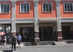 Pedestrians Walk In Front Of The Building &Amp; Loan Association Building In Kingstown On Thursday, Feb. 7. Prime Minister Dr. Ralph Gonsalves Announced Monday That There Was A $10 Million Run On The Institution In 2009.