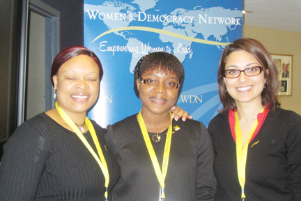 Former senator, Anesia Baptiste, centre, with participants from Zimbabwe and Tunisia at the annual International Women's Day Conference.