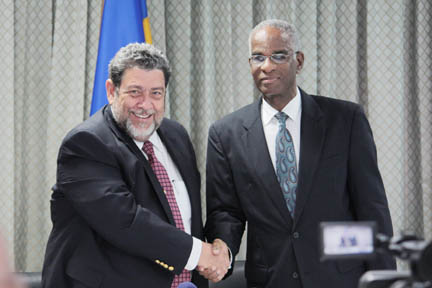 Prime Minister Dr. Ralph Gonsalves, left, and Anthony Bowen, executive vice president -- sales, Sagicor Life Inc., Barbados.