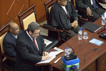 In this August 2012 photo, Prime Minister Dr. Ralph Gonsalves of St. Vincent and the Grenadines addresses the inaugural session of the OECS Assembly at the Parliament Building of Antigua and Barbuda. He told the assembly on Tuesday of his objection to economic citizenship.