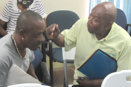 Former president, Alonzo Primus (left), in conversation with public relations officer, Sean Stanley.
